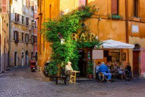 Piazza of Italian bar in old quarter of Trastevere, Rome
