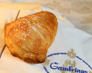 A typical Naples pastry, the sfogiatella, is often eaten with a coffee city cafes.