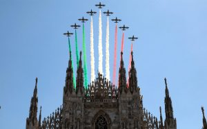 Italy's celebrated Frecce Tricolori Italian Air Force aerobatic display team colors skies red, white and green over the Cathedral of Milan.