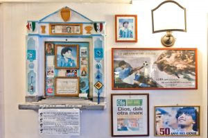 Altar of Diego Maradona tribute to famous Napoli soccer player at Bar Nilo in historic quarter of Naples, Italy