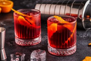 Negroni Italian cocktail made with Campari, gin and Martini Rosso vermouth and served with an orange twist.