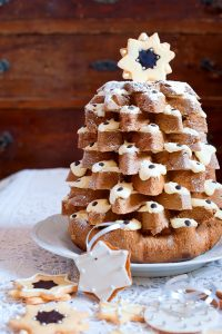 Pandoro Christmas cake in Italy is decorated with cream and chocolate.
