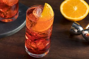 The Americano Italian cocktail made with Camapari, Prosecco and soda served with slice of organge. It was invented in Milan, Italy.