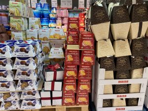 Boxes of Italian Christmas cakes panettone and pandoro at a local grocery store.