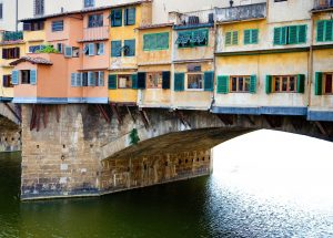 Detail of Ponte Vecchio, an ancient bridge in Florence, Italy covered with medieval shops selling gold jewelry.