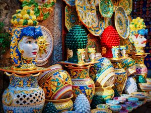 Colorful handpainted Sicilian ceramics in shape of heads, Testa di Moro with other cheerful ceramics