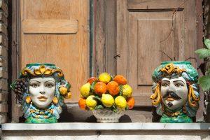 Colorful handpainted Sicilian ceramics in shape of heads, Testa di Moro