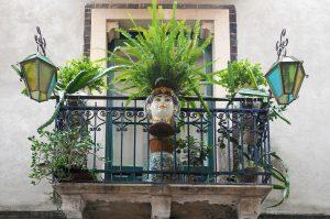 Colorful handpainted Sicilian ceramics in shape of heads, Testa di Moro. Decorate a balcony in Taormina, Sicily