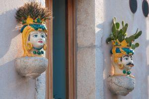 Colorful handpainted Sicilian ceramics in shape of heads, Testa di Moro. Decorate a house in Castelmola, Sicily