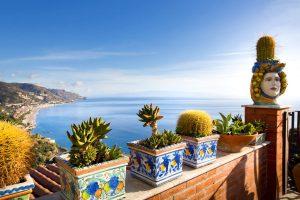 Colorful handpainted Sicilian ceramics in shape of heads, Testa di Moro. Decorate a balcony near Taormina, Sicily
