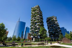 Milan, Italy - Bosco Verticale, vertical forest apartment buildings in the Porta Nuova area of the city with the UniCredit tower on the left, the tallest skyscraper in Italy.